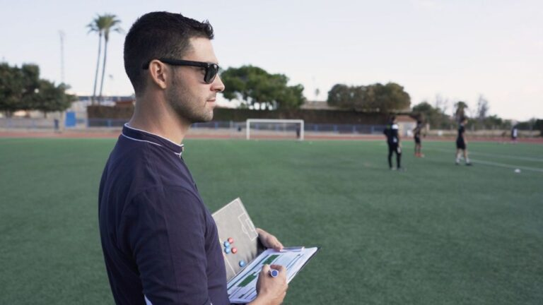 soccer scouted looking at players
