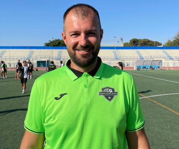 international academy coach in the soccer field in spain